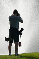 Photographer silhouetted in action during the third round of the Omega Dubai Desert Classic, Emirates Golf Club, Dubai, UAE. 26/01/2019<br /> Picture: Golffile | Phil Inglis<br /> <br /> <br /> All photo usage must carry mandatory copyright credit (© Golffile | Phil Inglis)