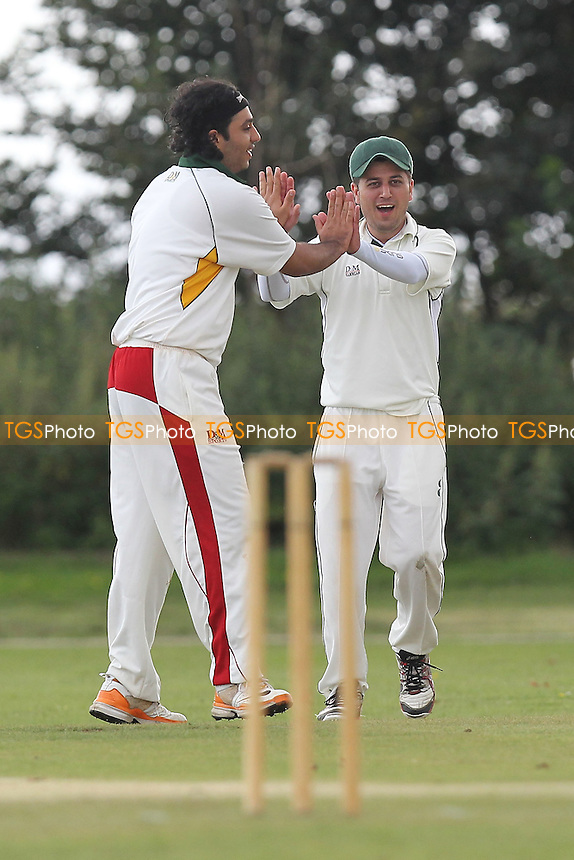 Harold Wood celebrate the first Stanford wicket - Stanford-Le-Hope CC (batting) vs Harold Wood CC - Essex Cricket League - 25/08/12 - MANDATORY CREDIT: Gavin Ellis/TGSPHOTO - Self billing applies where appropriate - 0845 094 6026 - contact@tgsphoto.co.uk - NO UNPAID USE.