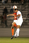 1 November 2006: Virginia's Ian Holder (front) wins a header against an unidentified Clemson player (behind). Virginia defeated Clemson 2-0 at the Maryland Soccerplex in Germantown, Maryland in an Atlantic Coast Conference college soccer tournament quarterfinal game.