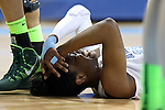 25 March 2014: North Carolina's Diamond DeShields holds her head after falling to the court in the first half. The University of North Carolina Tar Heels played the Michigan State University Spartans in an NCAA Division I Women's Basketball Tournament First Round game at Cameron Indoor Stadium in Durham, North Carolina. UNC won the game 62-53.