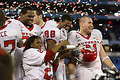 January 5th, 2008:  Ray Rice's mom holds up the MVP award as Pedro Sosa (77), Kenny Britt (88), and Ryan Blaszczyk (61) celebrate after the International Bowl at the Rogers Centre in Toronto, Ontario Canada...Rutgers defeated Ball State 52-30.  ..Photo By:  Mike Janes Photography