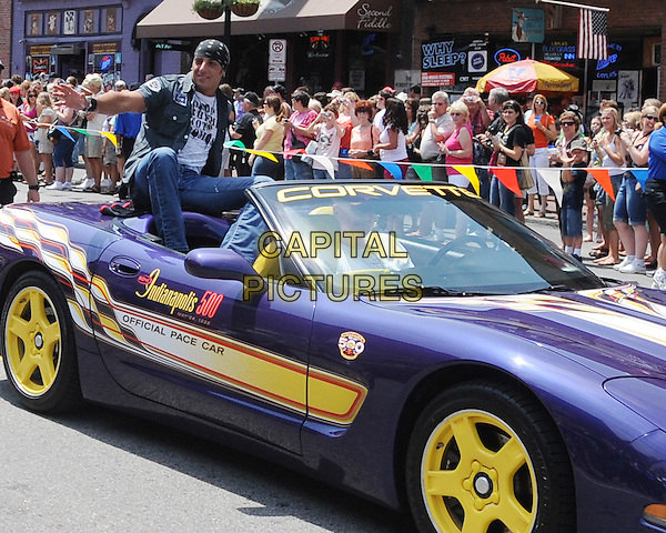 TRENT TOMLINSON .Rides in the 2009 CMA Music Festival Kick-off Parade, Nashville,TN, USA, .10th June 2009..car country music convertible corvette purple yellow sitting riding .CAP/ADM/MS.©Mike StrasingerAdmedia/Capital Pictures
