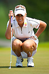 CHON BURI, THAILAND - FEBRUARY 19:  Natalie Gulbis of USA lines up a putt on the 1st green during day three of the LPGA Thailand at Siam Country Club on February 19, 2011 in Chon Buri, Thailand. Photo by Victor Fraile / The Power of Sport Images