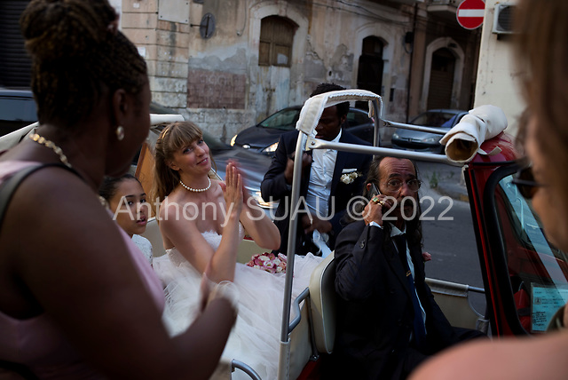 Ortiga, Sicily, Italy<br /> July 20, 2019<br /> <br /> The wedding of Christine Auger and Rodrique at an open air (roofless) Elgise (church) San Giovanni Battista in Ortigia, Sicily (Italy).