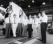 Dr. Wernher von Braun, Director of the U.S. Army Ballistic Missile Agency's (ABMA) Development Operations Division, is shown briefing the seven original Mercury astronauts in ABMA's Fabrication Laboratory. (Left to right) Guss Grissom, Walter Schirra, Alan Shepard, John Glenn, Scott Carpenter, Gordon Cooper, Donald Slayton, and Dr. von Braun..Credit: NASA via CNP