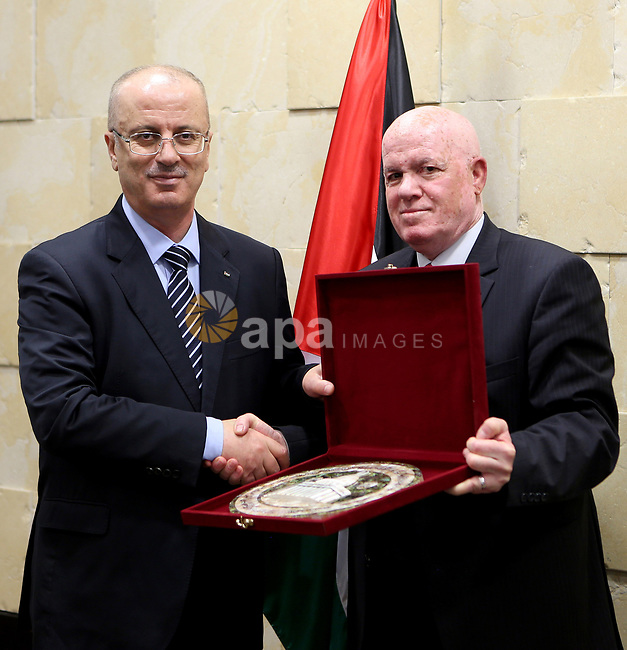Palestinian prime minister ,Rami Hamdallah, meets with Palestinian Health Minister Jawad Awad , in the West Bank city of Ramallah, on January 3, 2018. Photo by Prime Minister Office
