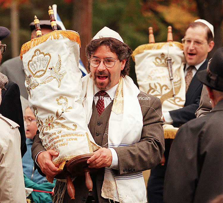 WATERBURY, CT. 10/13/98--1013SV05.tif--from left; Joel Burger and Mike Daskal carry the Torhas into Fulton Park while members of the Jewish community dance in to celebrate Simchat Torah on Tuesday. Two synagogues, from BÕnai Shalom and Beth El  participated in the event. Steven Valenti Photo