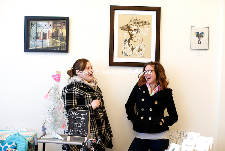 "Seymour, CT- 07 February 2015-020715CM02- Amanda Jo Barriga, left, with Thirty-One Gifts and Lindsy Smith, owner of Black Tabby Studio share a laugh during  ""Galentines Night Out at Alyssa DeMatteo's Wildflour Confections in Seymour on Saturday. The event was hosted by Alyssa Antonucci owner of Beads By Alyssa and DeMatteo. It included shopping, jewelry, cupcakes and treats, and ""girl talk.""  Christopher Massa Republican-American"
