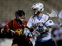 Jeff Muscatello (9) of North Carolina is defended by Dan Burns (4) of Maryland during the ACC men's lacrosse tournament semifinals in College Park, MD.  Maryland defeated North Carolina, 13-5.