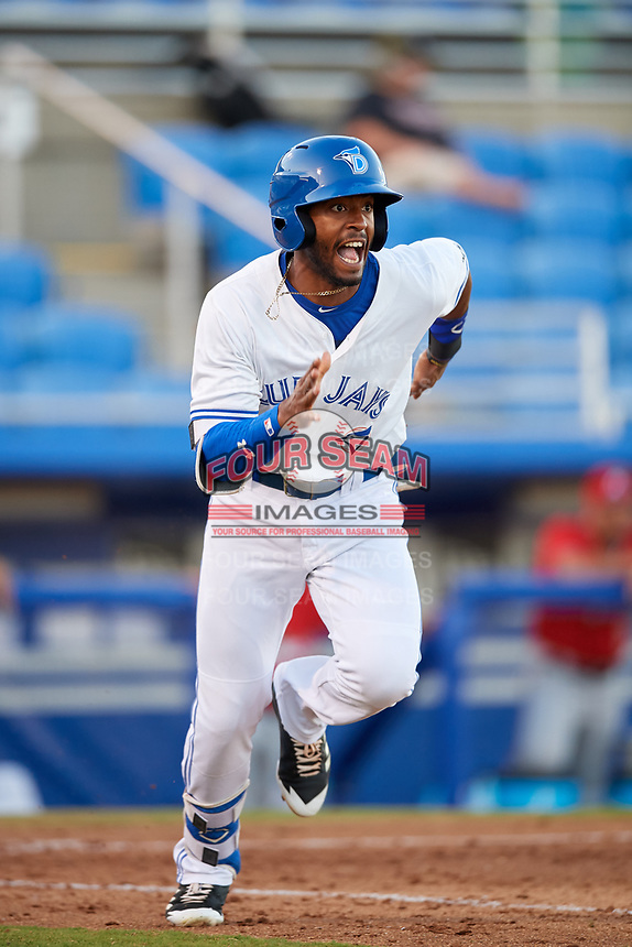 Dunedin Blue Jays right fielder Joshua Palacios (7) runs to first base during a game against the Fort Myers Miracle on April 17, 2018 at Dunedin Stadium in Dunedin, Florida.  Dunedin defeated Fort Myers 5-2.  (Mike Janes/Four Seam Images)