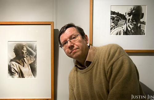 Alexander Lavrentiev (Lavrentyev), grandson of renowed Russian constructivist artist Alexander Rodchenko, poses for portrait at Rodchenko's exhibition in Moscow in front of a photograph of Varvara Stepanova (L) by Rodchenko and a photograph of Rodchenko by Stepanova(R). Picture by Justin Jin.