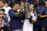 20 November 2011: Los Angeles' Landon Donovan (right) kisses the Philip F. Anschutz Trophy as Juninho (BRA) (left) holds it. The Los Angeles Galaxy defeated the Houston Dynamo 1-0 at the Home Depot Center in Carson, CA in MLS Cup 2011, Major League Soccer's championship game.