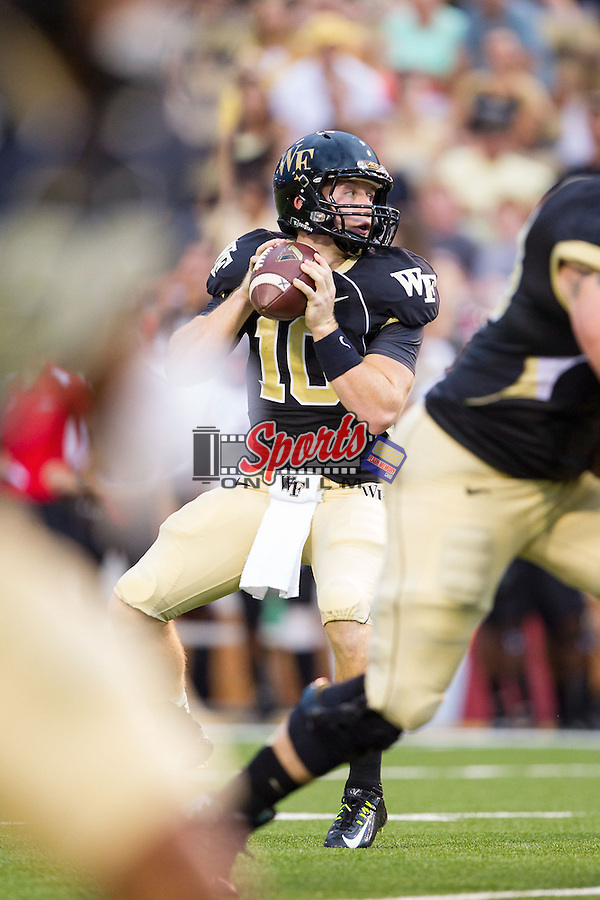 Wake Forest Demon Deacons quarterback John Wolford (10) drops back to pass during first half action against the Gardner-Webb Runnin' Bulldogs at BB&T Field on September 6, 2014 in Winston-Salem, North Carolina.  The Demon Deacons defeated the Runnin' Bulldogs 23-7.   (Brian Westerholt/Sports On Film)