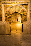 Richly inscribed stonework of keyhole shaped Mihrab, the centrepiece of the Great Mosque, Cordoba, Spain