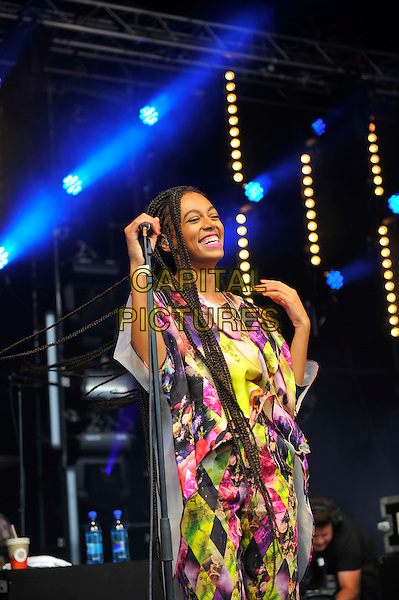 Solange (Solange Knowles) <br /> performing at Glastonbury Festival, Worthy Farm, Pilton, Somerset, <br /> England, UK, 28th June 2013.<br /> half length music gig concert gig live on stage microphone  long hair braids smiling pink yellow white print catsuit jumpsuit top <br /> CAP/MAR<br /> &copy; Martin Harris/Capital Pictures