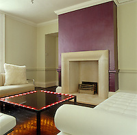 The coffee table with built-in lights and the fire surround in the contemporary living room were designed by Pip Isherwood