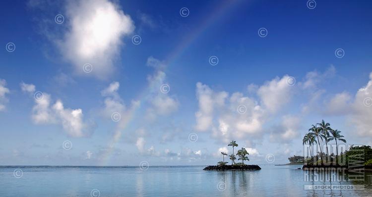 A rainbow over a small island off the coast of O'ahu