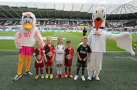 Pictured: Children mascots with Cyril and Cybil the swans. Saturday 23 August 2014<br />