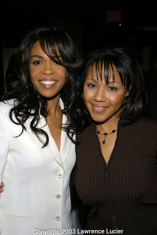 NEW YORK - DECEMBER 11: US TABS AND HOLLYWOOD REPORTER OUT Recording artists Michelle Williams and Erica Campbell appear at the after party for Williams' Broadway debut in the musical Aida December 11, 2003, at LQ in New York City.