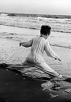 Boy doing splits in the waves