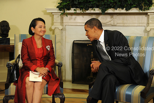 Washington, DC - July 30, 2009 -- United States President Barack Obama meets with President Gloria Macapagal-Arroyo of the Philippines in the Oval Office of the White House in Washington DC, USA 30 July 2009.  Obama and Arroyo discussed security, the environment and Myanmar (Burma) among other issues.   .Credit: Michael Reynolds - Pool via CNP