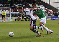 Paul McGowan beats George Francomb in the St Mirren v Hibernian Clydesdale Bank Scottish Premier League match played at St Mirren Park, Paisley on 29.4.12.