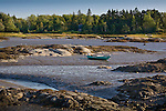 Low tide strands a small boat in South Thomaston, ME, USA