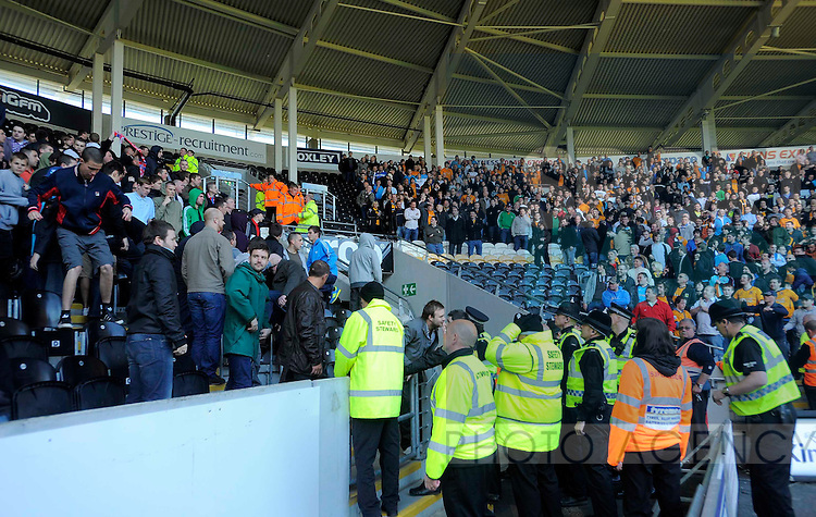 Trouble breaks out between Hull City and Liverpool fans at the end of the game.