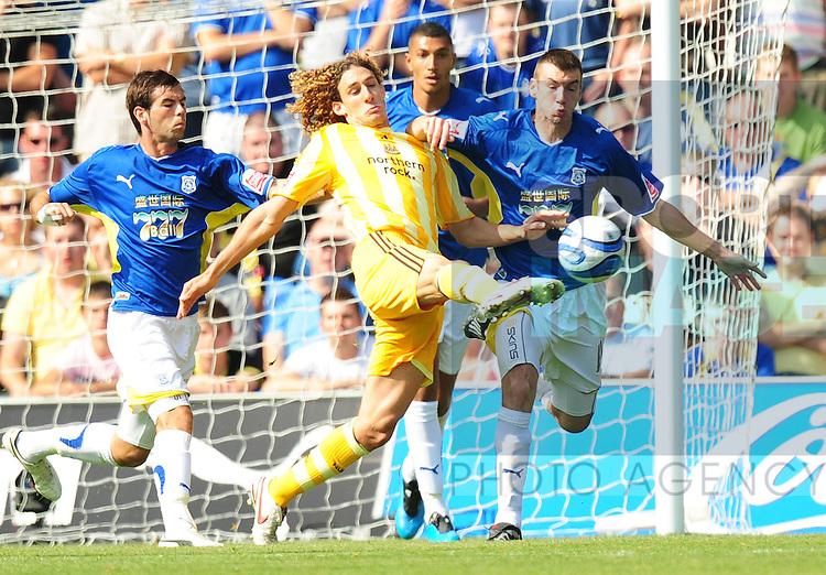 Match winning goalscorer Fabrizo Coloccini of Newcastle United has an attempt on goal