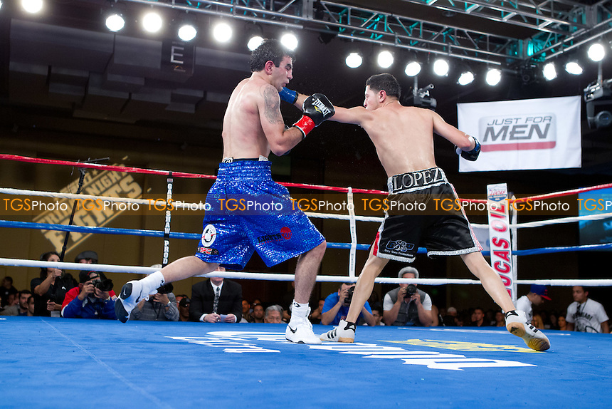Abraham Lopez in black shorts defeated Gabriel Tolmajyan in blue shorts in their featherweight boxing contest - ESPN Friday Night Fights at the Morongo Casino Resort & Spa in Cabezon, California - 16/3/2012 - Dwight McCann/TGSPHOTO - Self billing applies where appropriate - 0845 094 6026 - contact@tgsphoto.co.uk - NO UNPAID USE
