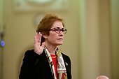 """Marie """"Masha"""" Yovanovitch, former United States Ambassador to Kyiv, Ukraine, on behalf of the US Department of State, is sworn-in to testify during the US House Permanent Select Committee on Intelligence public hearing as they investigate the impeachment of US President Donald J. Trump on Capitol Hill in Washington, DC on Friday, November 15, 2019.<br /> Credit: Ron Sachs / CNP<br /> (RESTRICTION: NO New York or New Jersey Newspapers or newspapers within a 75 mile radius of New York City)"""
