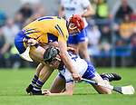 John Conlon of Clare  in action against Michael Walsh of Waterford during their Munster  championship round robin game at Cusack Park Photograph by John Kelly.