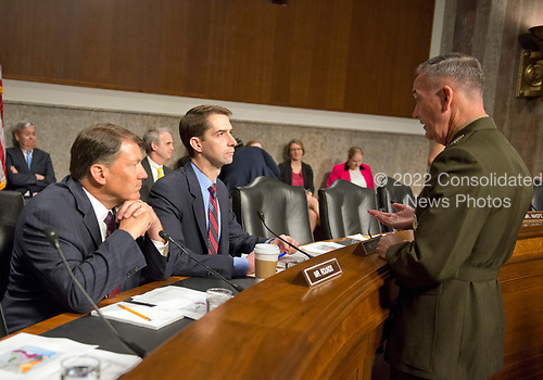 """General Joseph F. Dunford, Jr., US Marine Corps, Chairman of the Joint Chiefs of Staff, right, speaks with United States Senators Mike Rounds (Republican of South Dakota), left and Tom Cotton (Republican of Arkansas), center, before giving testimony before the US Senate Committee on Armed Services on """"the Department of Defense budget posture in review of the Defense Authorization Request for Fiscal Year 2018 and the Future Years Defense Program"""" on Capitol Hill in Washington, DC on Tuesday, June 13, 2017.<br /> Credit: Ron Sachs / CNP"""