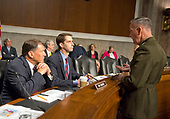 "General Joseph F. Dunford, Jr., US Marine Corps, Chairman of the Joint Chiefs of Staff, right, speaks with United States Senators Mike Rounds (Republican of South Dakota), left and Tom Cotton (Republican of Arkansas), center, before giving testimony before the US Senate Committee on Armed Services on ""the Department of Defense budget posture in review of the Defense Authorization Request for Fiscal Year 2018 and the Future Years Defense Program"" on Capitol Hill in Washington, DC on Tuesday, June 13, 2017.<br /> Credit: Ron Sachs / CNP"