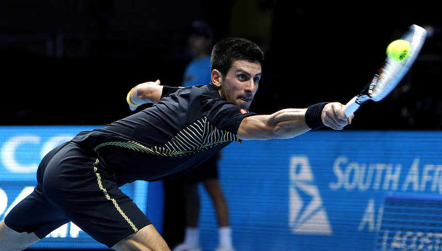 Novak Djokovic (SRB) in action today during his victory over Roger Federer (SUI) today in their Singles Final match - Novak Djokovic (SRB) def Roger Federer (SUI) 7-6 7-5..International Tennis - Barclays ATP World Tour Finals - O2 Arena - London - Day 8 Monday 12th November 2012..