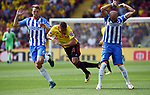 Richarlison of Watford is challenged by Bruno Saltor of Brighton & Hove Albion during the premier league match at the Vicarage Road Stadium, Watford. Picture date 26th August 2017. Picture credit should read: Robin Parker/Sportimage