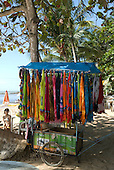 Praia da Concha, Itacare, Bahia State, Brazil. beach seller's cart with colourful tangas.