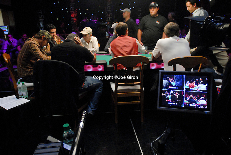 A view of the TV final table and camera monitors.