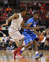 Ohio State Buckeyes forward Sam Thompson (12) guards Central Connecticut State Blue Devils guard Matt Hunter (25) as he takes the ball down court in the second half of the college basketball game between the Ohio State Buckeyes and the Central Connecticut State Blue Devils at Value City Arena in Columbus, Saturday afternoon, December 7, 2013. The Ohio State Buckeyes defeated the Central Connecticut State Blue Devils 74 - 56. (The Columbus Dispatch / Eamon Queeney)
