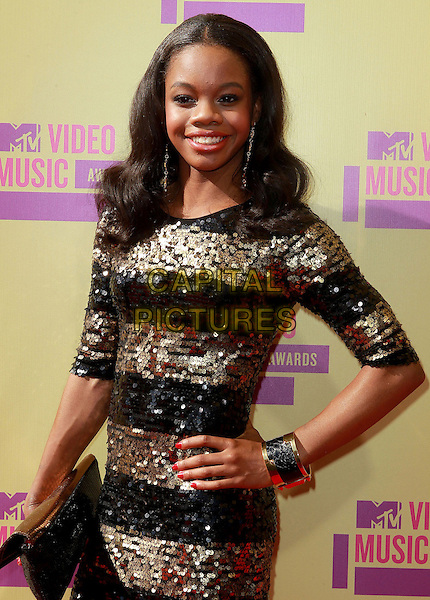 Gabby Douglas, Gabrielle Douglas.The 2012 MTV Video Music Awards held at Staples Center in Los Angeles, California, USA..September 6th, 2012.VMA's VMAS VMA half length black dress gold sequins sequined clutch bag hand on hip bracelet .CAP/ADM/KB.©Kevan Brooks/AdMedia/Capital Pictures.