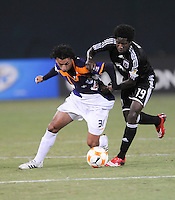 Deportivo Saprissa midfielder Michael Barrantes (31) keeps possession of the ball against DC United midfielder Clyde Simms (19), Deportivo Saprissa defeated DC United 2-0,  in the first leg of group A of the Concacaf Champions League, Tuesday  September 16 , 2008 at RFK Stadium.
