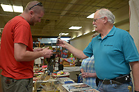 NWA Democrat-Gazette/BEN GOFF @NWABENGOFF<br /> Patrick Clanton (left) of Pea Ridge looks at a custom knife made by Jack Waxenfelter of Berryville Sunday, May 7, 2017, during the spring Frisco Station Mall Arts and Crafts Festival in Rogers.