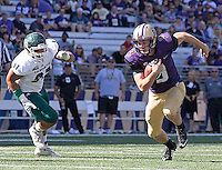 Quarterback Jake Browning scrambles for a first down.