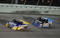 Nov. 14, 2008; Homestead, FL, USA; NASCAR Craftsman Truck Series driver Ron Hornaday Jr leads Johnny Benson during the Ford 200 at Homestead Miami Speedway. Mandatory Credit: Mark J. Rebilas-
