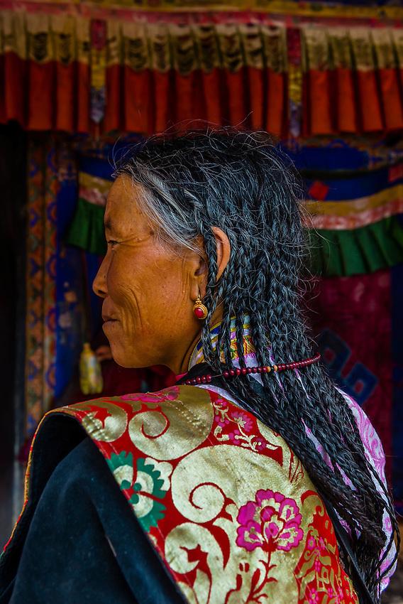 Tibetan woman, Ganden Monastery, Dagze, Tibet (Xizang), China.