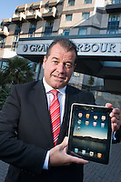 Portrait of Devere Grand Harbour Hotel Southampton General Manager Steve Grant with an Apple iPad.??Date Taken: 20/10/10??Location:?Grand Harbour Hotel?Southampton??Contact:?Steve Grant, Tamsin Raper (PA to General Manager) 0121 262 3900??Commissioned by:  Lisa Ellams?Fleet Street Consulting?Fleet Street Consulting Ltd..8 Fleet Street.Birmingham.B3 1JH.T: 0121 262 3900.F: 0121 233 2583