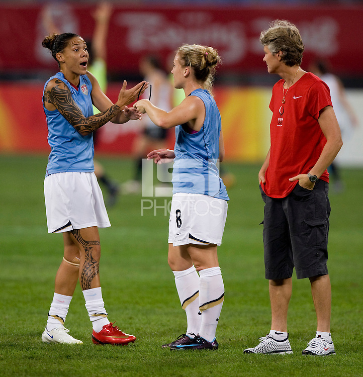 Pia Sundhage, Amy Rodriguez, Natasha Kai. The USWNT defeated New Zealand, 4-0, during the 2008 Beijing Olympics in Shenyang, China.  With the win, the USWNT won group G and advanced to the semifinals.