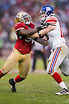 San Francisco 49ers linebacker Parys Haralson (98) battles against New York Giants tight end Jake Ballard (85) during an NFC Championship NFL football game on January 22, 2012 in San Francisco, California. The Giants won 20-17 in overtime. (AP Photo/David Stluka)