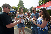 NWA Democrat-Gazette/BEN GOFF @NWABENGOFF<br /> Dan Looney (from left) of Bentonville, Caitlyn Walters of Fayetteville, Markus King and wife Denise King of Fayetteville sample barbecue from local teams Saturday, June 17, 2017, during the Rodeo of the Ozarks Western Days on the Shiloh Square in downtown Springdale. The event, held at Parsons Stadium in previous years, featured a barbecue cook off, stage coach rides, a battle of the bands and more.
