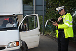 © Joel Goodman - 07973 332324 . 16 August 2013 . Manchester , UK . Inspector Bailey-Smith stops a van driver with a smashed windscreen . Drive along with Inspector Matt Bailey-Smith ( 16366 ) of Greater Manchester Police 's Serious Collision Unit . Photo credit : Joel Goodman